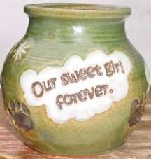 green pet urn with inscripted hearts