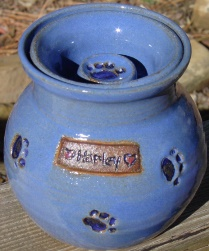small pet urn with small paw prints